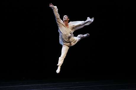Wearing makeup done by Smuin ballet wardrobe assistant Vincent Avery, Ben Needham-Wood takes to the air during the final dress rehearsal at Yerba Buena Center for the Arts in san Francisco, Calif.