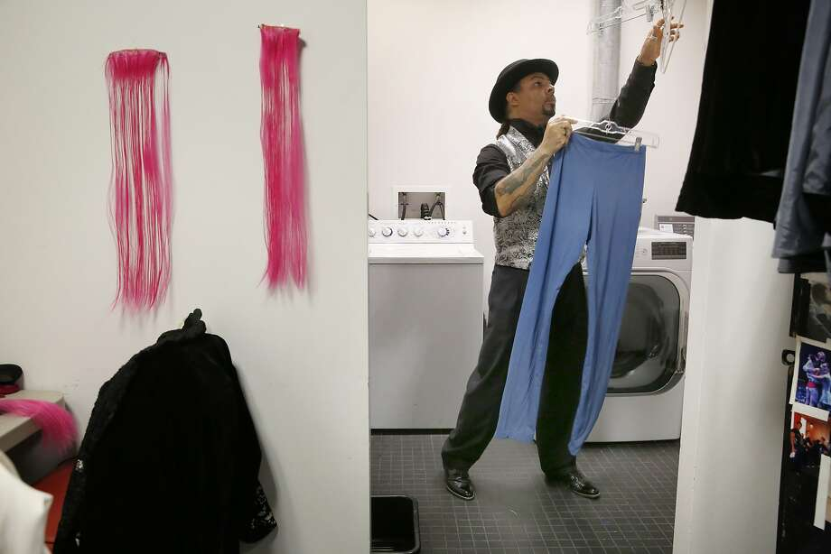 Washing and hanging dancers clothes as they come off stage during final dress rehearsal, Smuin ballet wardrobe assistant Vincent Avery preps for opening night at the Yerba Buena Center for the Arts in san Francisco, Calif. Photo: Mike Kepka, The Chronicle