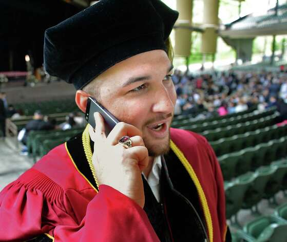 Zach Powers of Knoxville, Tenn., on his cell phone before the start of Albany Law School Commencement Ceremonies at Saratoga Performing Arts Center Friday May 15, 2015 in Saratoga Springs, NY.  (John Carl D'Annibale / Times Union) Photo: John Carl D'Annibale, Albany Times Union / 00031496A