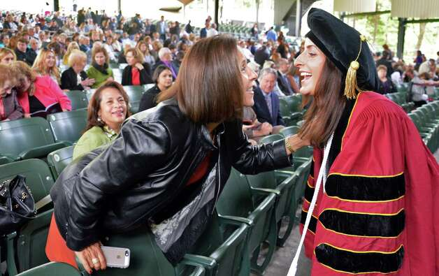 Maura Dughi, left, embraces her daughter Jamie Dughi Hogenkamp before the start of Albany Law School Commencement Ceremonies at Saratoga Performing Arts Center Friday May 15, 2015 in Saratoga Springs, NY.  (John Carl D'Annibale / Times Union) Photo: John Carl D'Annibale, Albany Times Union / 00031496A