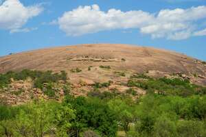 "In a recent poll, Texas Parks & Wildlife named Enchanted Rock Texas' no. 1 state park, even though it's really a ""natural area."""