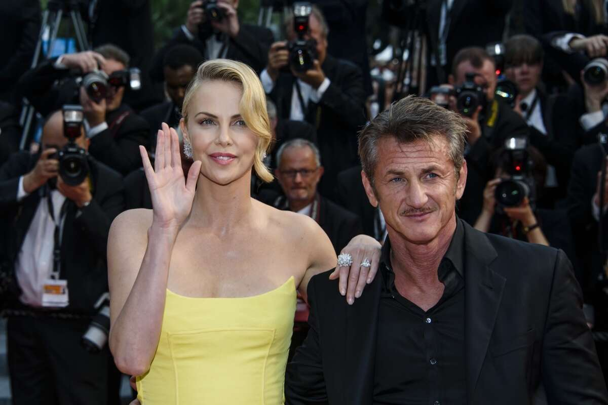 """Actors Sean Penn and Charlize Theron attend the premiere of """"Mad Max: Fury Road"""" during the 68th annual Cannes Film Festival on May 14, 2015 in Cannes, France. (Photo by Clemens Bilan/Getty Images)"""