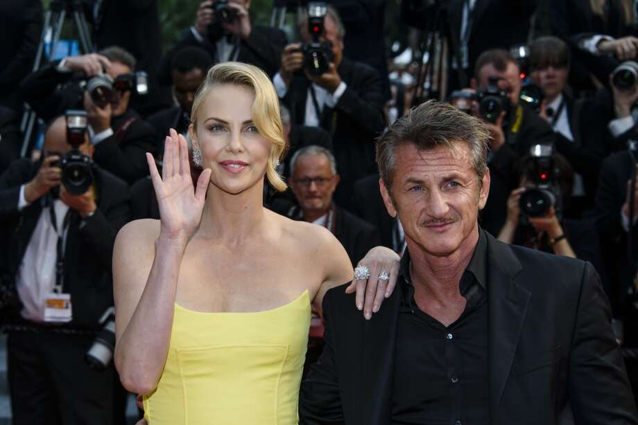 "Actors Sean Penn and Charlize Theron attend the premiere of ""Mad Max: Fury Road"" during the 68th annual Cannes Film Festival on May 14, 2015 in Cannes, France.  (Photo by Clemens Bilan/Getty Images) Photo: Clemens Bilan, Getty Images"