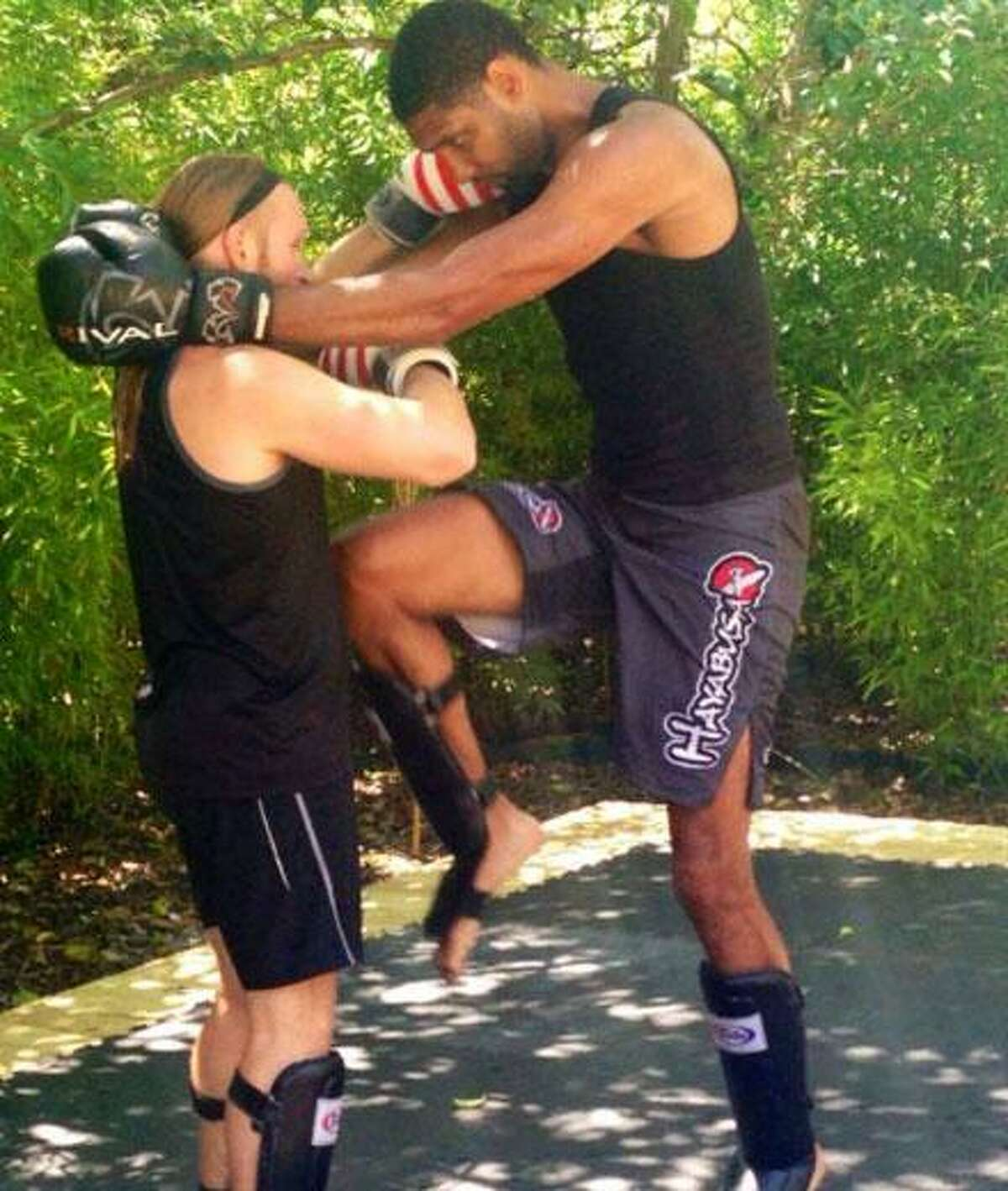 Tim Duncan with his martial arts/kickboxing trainer Jason Echols. May, 2015