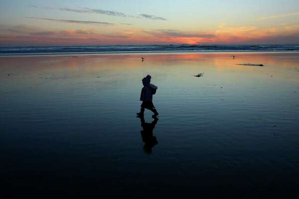 A child walks along Hobuck Beach near the loft RV park cabins at Hobuck Beach Resort on Saturday October 25, 2008 on the Makah Indian reservation. (Photo/Seattle Post-Intelligencer/Joshua Trujillo)