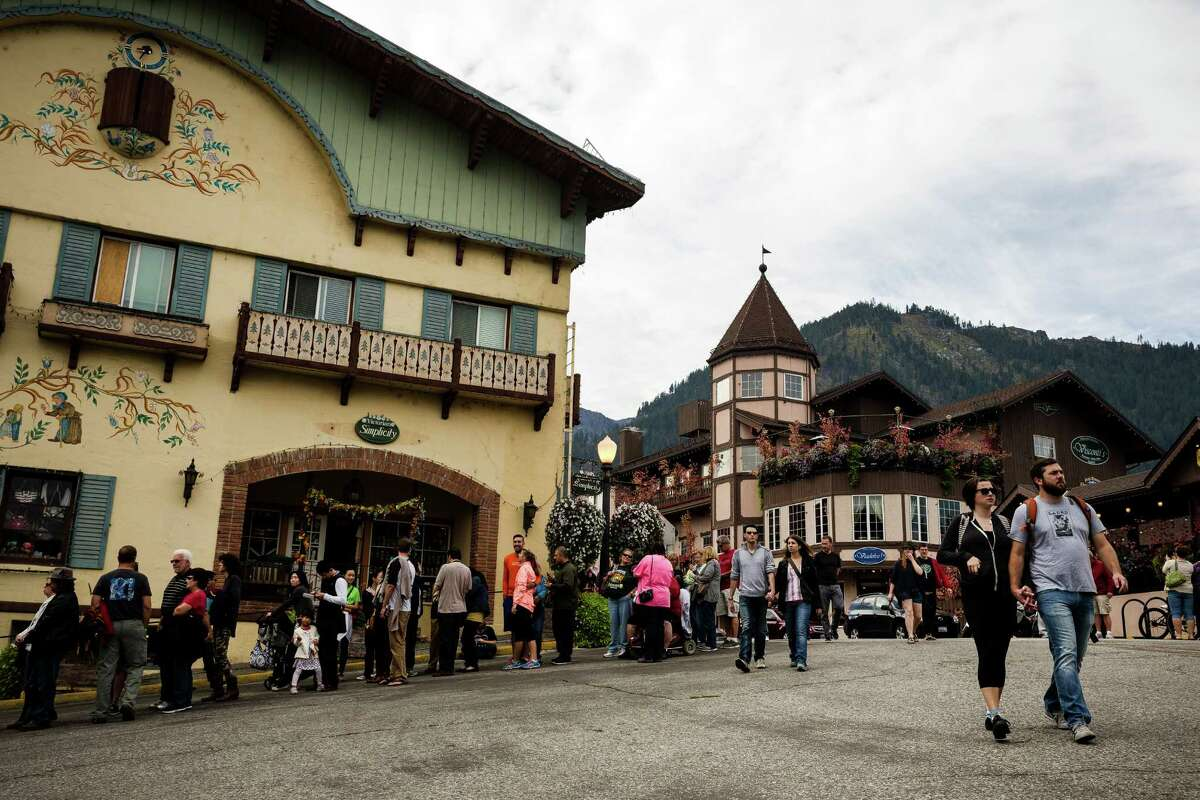 Lines of eager attendees form outside of eateries and beer halls on the first weekend of the annual Leavenworth Oktoberfest Saturday, October 4, 2014, in Leavenworth, Washington.