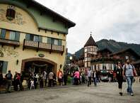 Lines of eager attendees form outside of eateries and beer halls on the first weekend of the annual Leavenworth Oktoberfest Saturday, October 4, 2014, in Leavenworth, Washington. The first Leavenworth Oktoberfest was held in October 1998 which was attended by about 400 people. Today more than a million tourists come to Leavenworth each year to celebrate. Leavenworth Oktoberfest continues on October 10-11 and 17-18. (Jordan Stead, seattlepi.com)