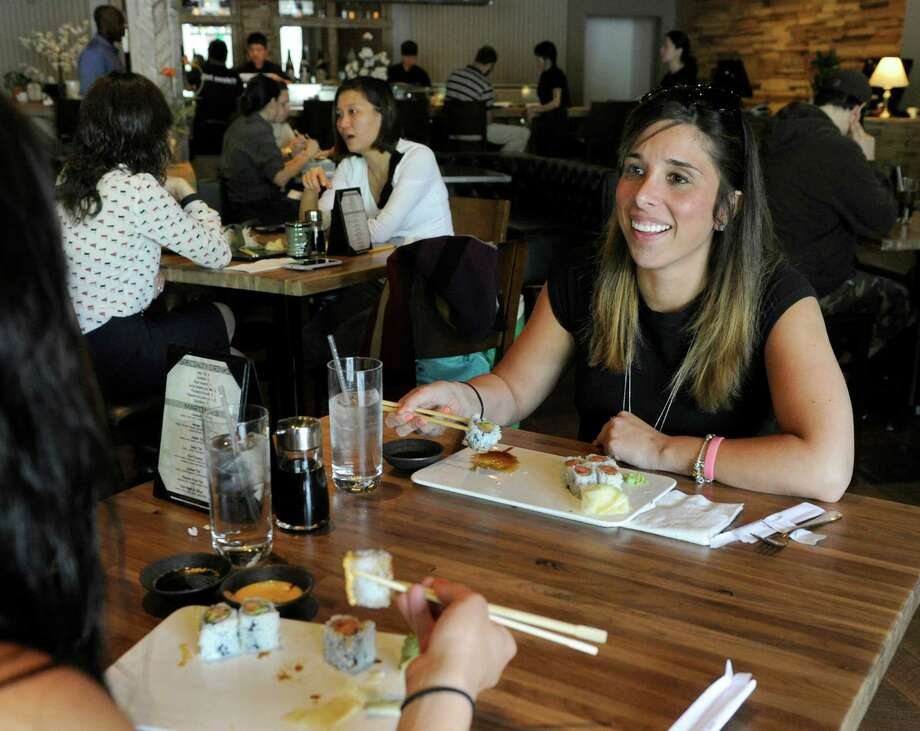 Christina Samaha, left, of Brewster and Lindsay Hornyak, of Danbury, have lunch together at Zen in Danbury, Conn., Friday, May 15, 2015. Zen is located at 40 Mill Plain Road in Danbury. Photo Friday, may 15, 2015. Photo: Carol Kaliff / The News-Times