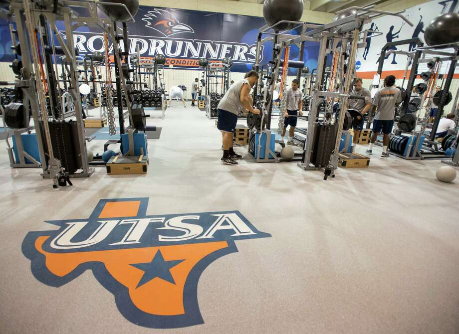 UTSA football players work out during a UTSA football off-season strength training session,  July 26, 2013, at UTSA in San Antonio. Photo: Darren Abate /For The Express-News / San Antonio Express-News