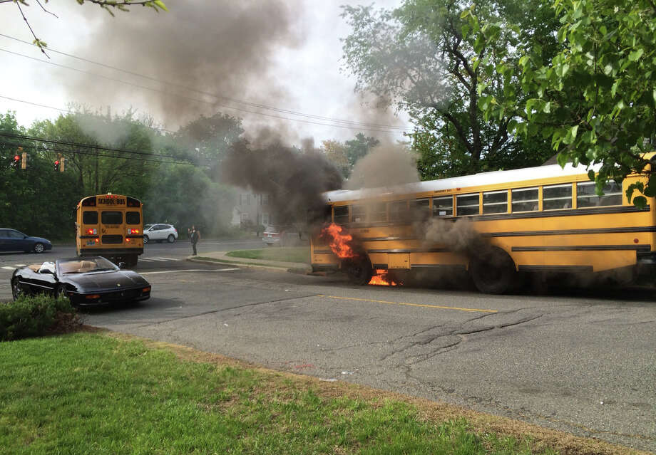 A Stamford school bus burned up in a dramatic fire on Old Barn Road in the Bull's Head area of Stamford, Conn. on Friady, May 15, 2015. There were no kids on bus, and the driver escaped uninjured. The cause of the fire was not yet known. Photo: Contributed Photo, Tim Grant/Contributed Photo / Stamford Advocate  contributed