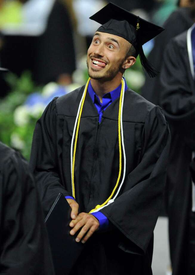 Southern Connecticut State University graduate Jim Russo, of Wallingford, walks across the stage to accept his diploma during the undergraduate commencement ceremony Friday, May 15, 2015 at the Webster Bank Arena in Bridgeport, Conn. Photo: Autumn Driscoll / Connecticut Post