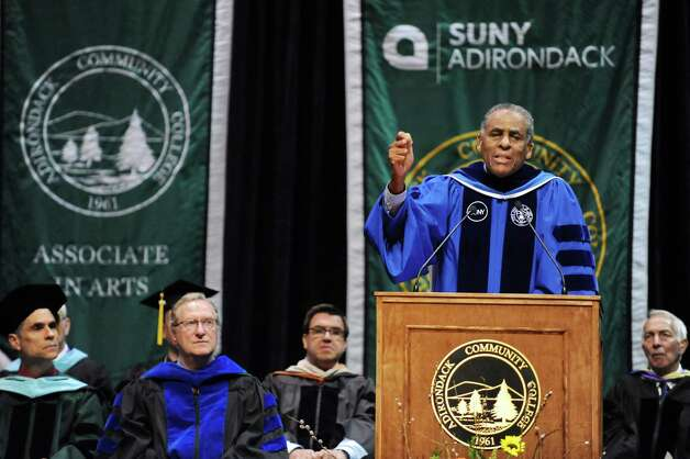 H. Carl McCall, SUNY chairman, right, speaks  during commencement exercises on Thursday, May 14, 2015, at Glens Falls Civic Center in Glens Falls, N.Y. (Cindy Schultz / Times Union) Photo: Cindy Schultz, Albany Times Union / 00031515A