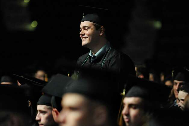 Graduate Adirondack graduate Nicholas Harding stands as he is recognized during commencement exercises on Thursday, May 14, 2015, at Glens Falls Civic Center in Glens Falls, N.Y. (Cindy Schultz / Times Union) Photo: Cindy Schultz, Albany Times Union / 00031515A