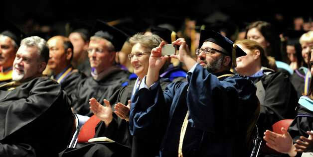 Faculty applaud their collieagues during SUNY Adirondack commencement exercises on Thursday, May 14, 2015, at Glens Falls Civic Center in Glens Falls, N.Y. (Cindy Schultz / Times Union) Photo: Cindy Schultz, Albany Times Union / 00031515A