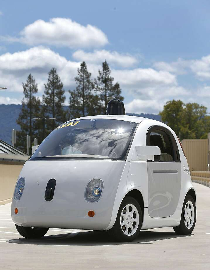 In this May 13, 2015 photo, Google's new self-driving prototype car drives around a parking lot during a demonstration at Google campus in Mountain View, Calif.  The car, which needs no gas pedal or steering wheel, will make its debut on public roads this summer. (AP Photo/Tony Avelar) Photo: Tony Avelar, Associated Press
