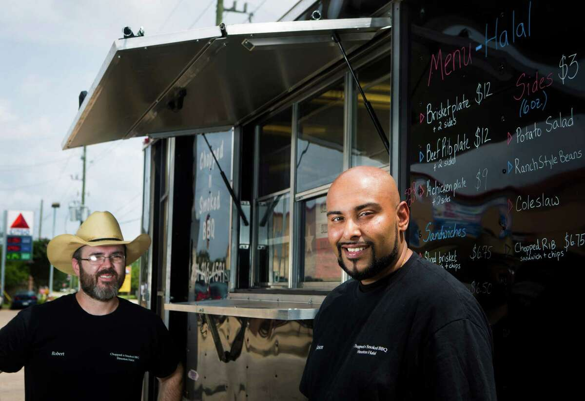 Robert West, left, and Jason Bones, right, have opened the Chopped N Smoked BBQ trailer in Sugar Land. The meat the serve is all halal which is permissible for consumption according to Islamic law. Friday, May 8, 2015, in Sugar Land. ( Marie D. De Jesus / Houston Chronicle )