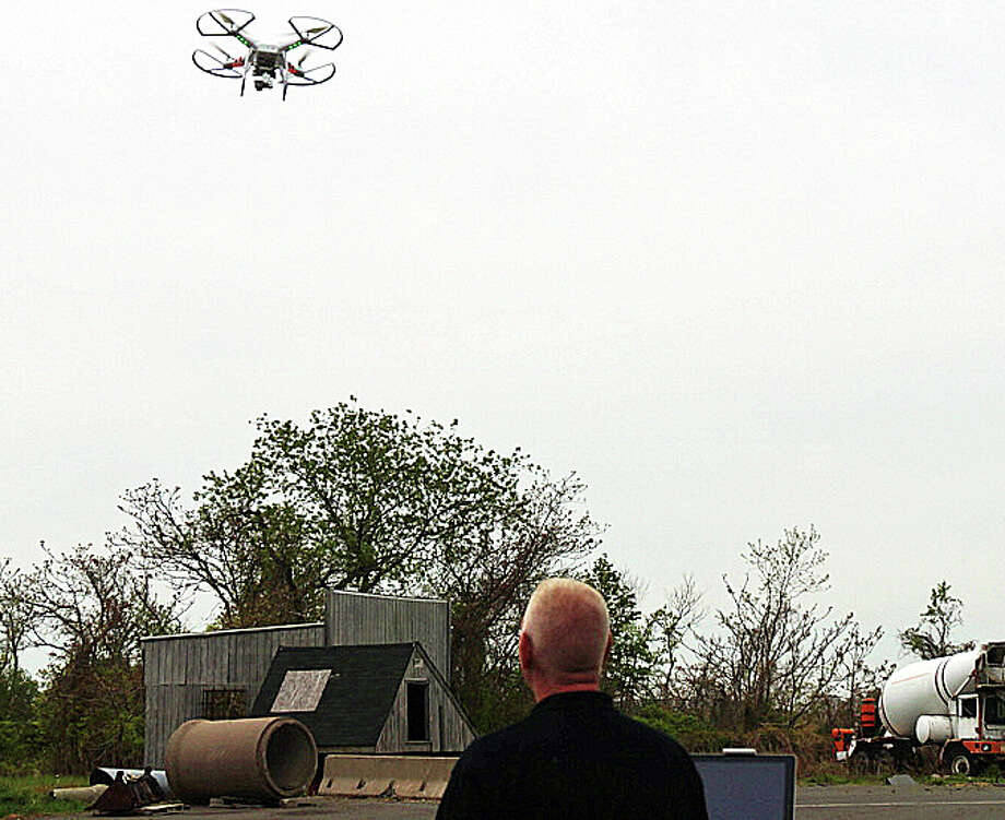 Chris Costello, of DART Drones, demonstrates the latest tool of the Fairfield County Hazardous Incident Response Team during training Friday at the Fire Training Center in Fairfield. Photo: Genevieve Reilly / Fairfield Citizen