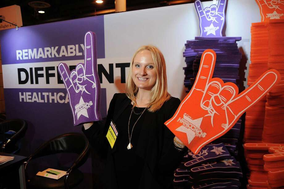 Kjerstie Johnson of CareATC promotes her company's health care services this week at the Gulf Coast Symposium on HR Issues at NRG Center. CareATC runs medical clinics on-site or near workplaces. The company has 101 clients in 23 states. Photo: Dave Rossman, Freelance / Freelalnce