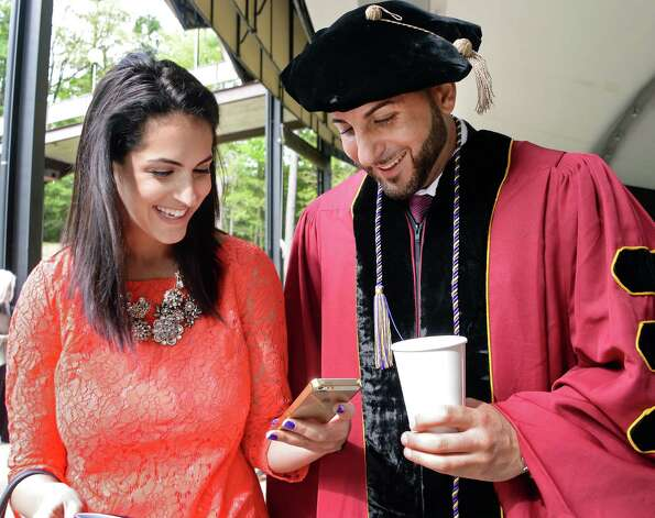Zayna Ibrahim of Albany with her brother Albany Law School graduate Saeed Ibrahim before the start of  Commencement Ceremonies at Saratoga Performing Arts Center Friday May 15, 2015 in Saratoga Springs, NY.  (John Carl D'Annibale / Times Union) Photo: John Carl D'Annibale / 00031496A