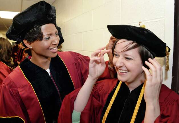 Graduates Jordine Jones, left, and Cara Janes await the start of Albany Law School Commencement Ceremonies at Saratoga Performing Arts Center Friday May 15, 2015 in Saratoga Springs, NY.  (John Carl D'Annibale / Times Union) Photo: John Carl D'Annibale / 00031496A