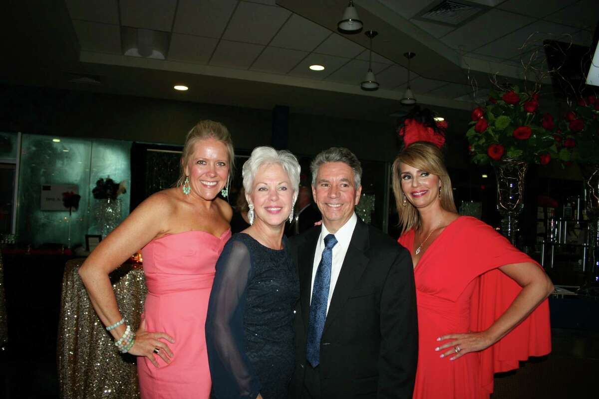 From left, Debbie Buckner, president of the Fort Bend Junior Service League; Mary and Carl Favre, honorary chairs; and Ashley Van Hoozen, event chair, welcomed guests to the April 11