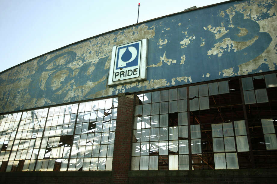The faded original Curtiss sign can still be seen on the historic Curtiss hangar at Sikorsky Airport in Stratford on Thursday, December 13, 2012. Photo: Brian A. Pounds / Connecticut Post