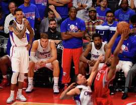 The Clippers' Blake Griffin (seated, second from left) watches during Thursday's second half. Los Angeles blew a 19-point lead against Houston, sending the series to Game 7.