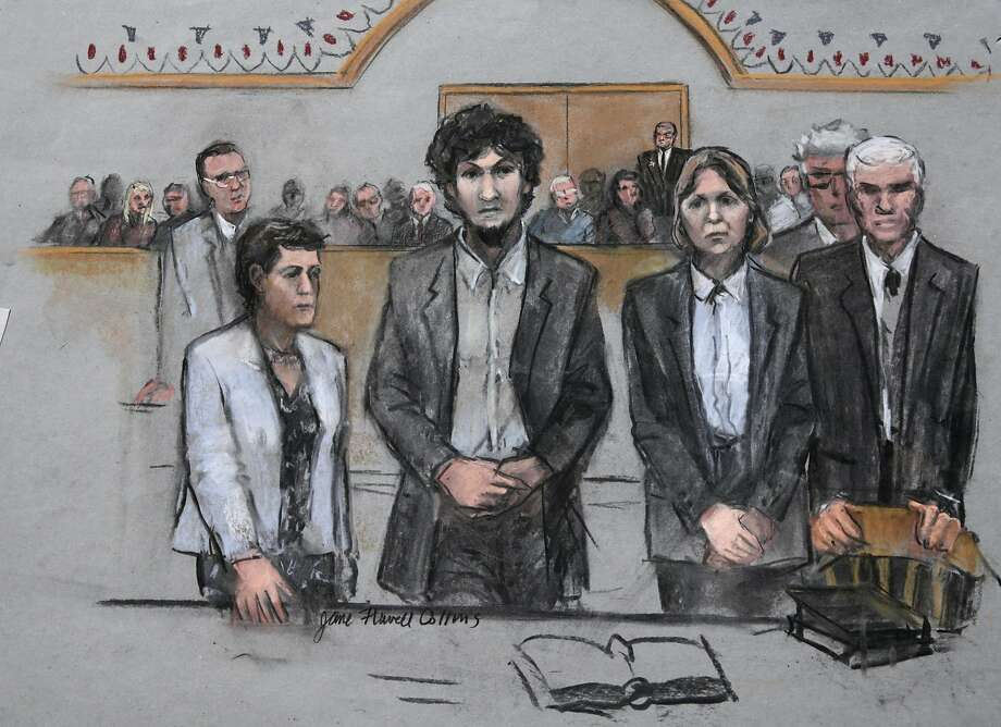 In this courtroom sketch, Boston Marathon bomber Dzhokhar Tsarnaev, center,  stands with his defense attorneys as a death by lethal injection sentence is read at the Moakley Federal court house in the penalty phase of his trial in Boston, Friday, May 15, 2015. The federal jury ruled that the 21-year-old Tsarnaev should be sentenced to death for his role in the deadly 2013 attack. (Jane Flavell Collins via AP) Photo: Jane Flavell Collins, Associated Press