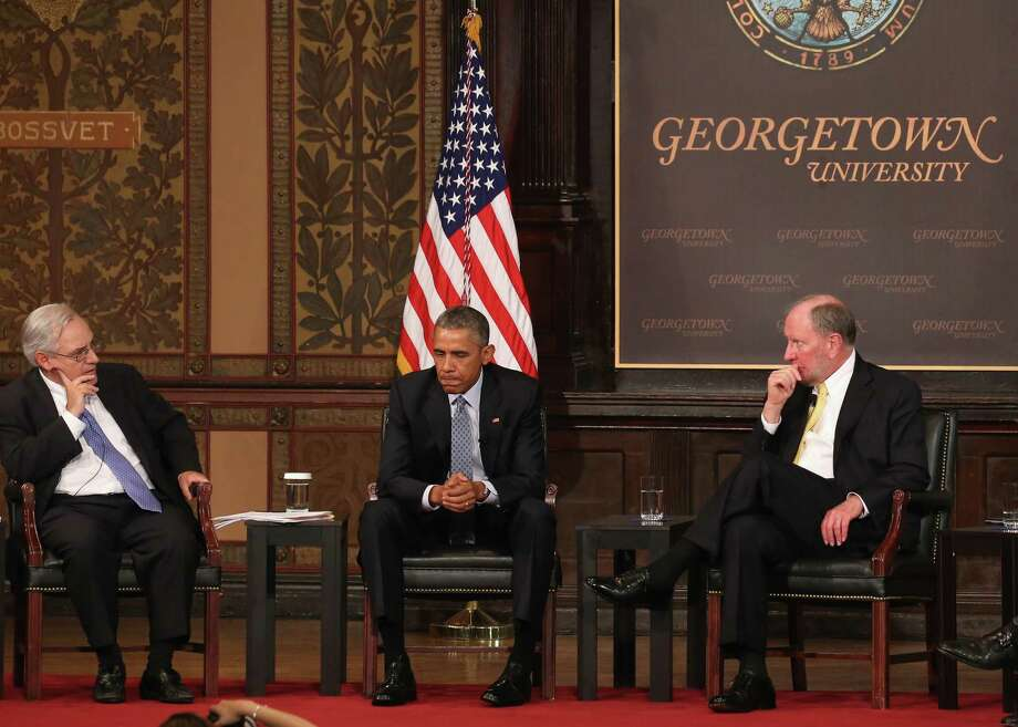 President Barack Obama participates in a discussion on poverty with moderator E.J. Dionne (left), a Washington Post columnist, and Robert Putman, a Harvard professor, at Georgetown University in Washington, D.C., on Tuesday. Photo: Mark Wilson /Getty Images / 2015 Getty Images