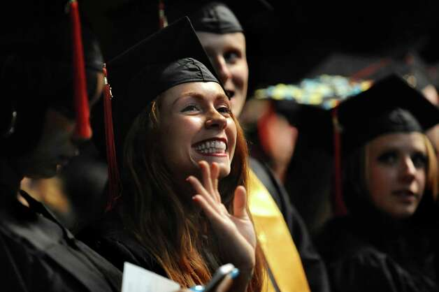 SUNY Plattsburgh graduate Kayla DeCelle of Troy, center, waves to her family during commencement exercises on Thursday, May 14, 2015, at Glens Falls Civic Center in Glens Falls, N.Y. (Cindy Schultz / Times Union) Photo: Cindy Schultz / 00031515A
