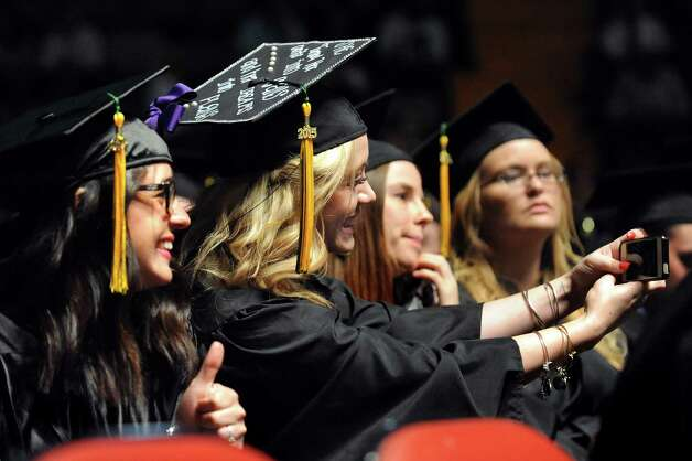 SUNY Adirondack graduatesNicole Cirelli, left, and Kaitlyn Gargiulo, center, take a selfie during commencement exercises on Thursday, May 14, 2015, at Glens Falls Civic Center in Glens Falls, N.Y. (Cindy Schultz / Times Union) Photo: Cindy Schultz / 00031515A