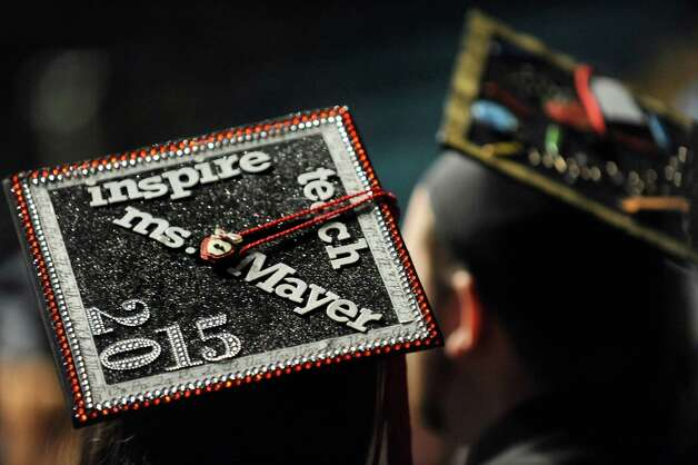 Graduates wear decorated mortar boards during commencement exercises on Thursday, May 14, 2015, at Glens Falls Civic Center in Glens Falls, N.Y. (Cindy Schultz / Times Union) Photo: Cindy Schultz / 00031515A