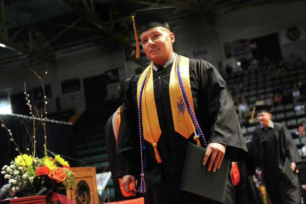 SUNY Adirondack graduate Brandon Faiola receives his diploma during commencement exercises on Thursday, May 14, 2015, at Glens Falls Civic Center in Glens Falls, N.Y. (Cindy Schultz / Times Union) Photo: Cindy Schultz / 00031515A