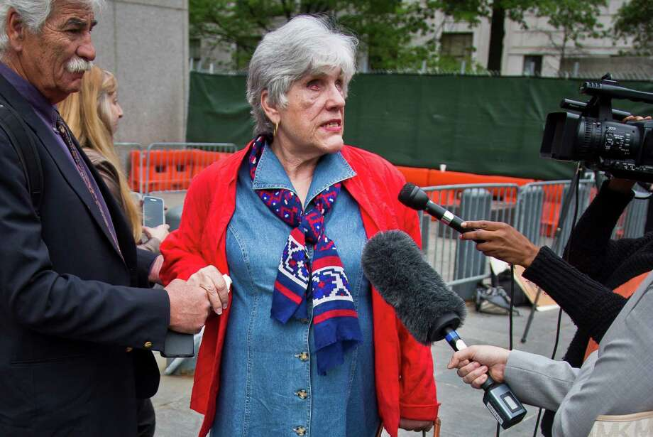Ellen Karas, blinded in the 1998 bombing attacks on two U.S. embassies in Africa, speaks with the media as she leaves court Friday. She told Khaled al-Fawwaz that they worshipped the same God, but a God who is not vengeful. Photo: Bebeto Matthews, STF / AP