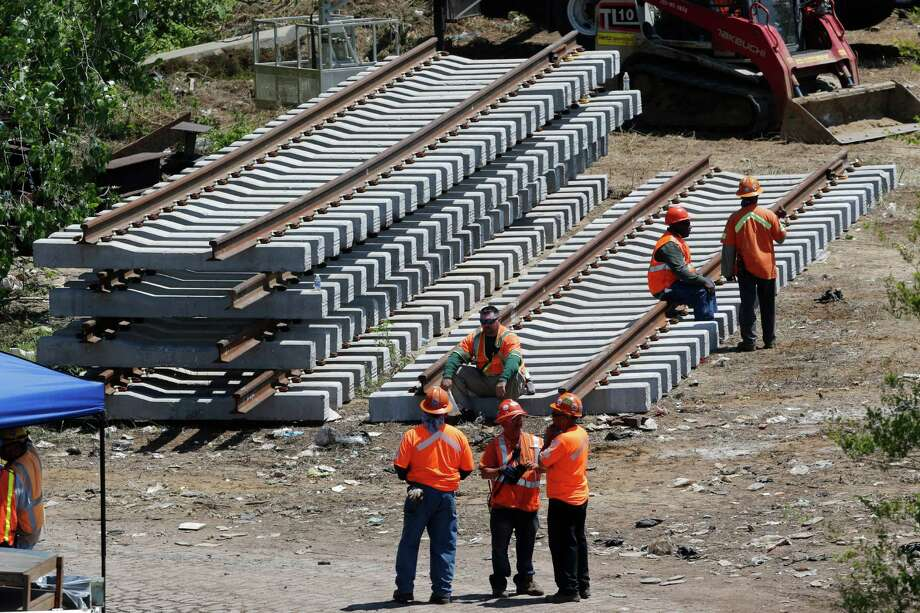 New rail lines are stacked up in an area near the site where a deadly train derailment occurred earlier in the week, Friday, May 15, 2015, in Philadelphia. Amtrak is working to restore Northeast Corridor rail service between New York City and Philadelphia. Service was suspended after a train derailed in Philadelphia on Tuesday night, killing eight passengers and injuring more than 200. (AP Photo/Julio Cortez) Photo: Julio Cortez, STF / AP