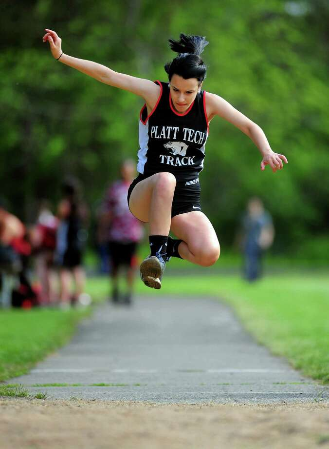 Platt Tech's Nicole Allen competes in the long jump, during boys and girls track action at Platt Tech in Milford, Conn., on Friday May 15, 2015. Photo: Christian Abraham / Connecticut Post