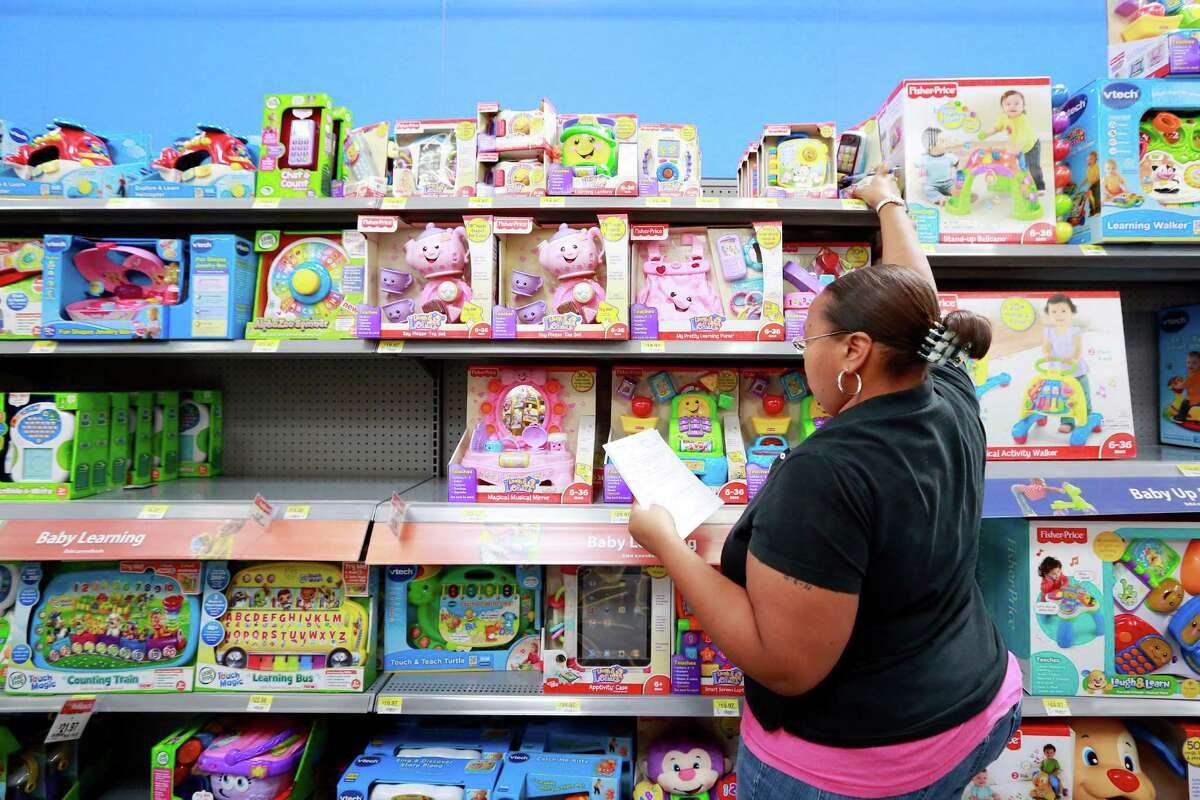 A Child Protective Services case worker shops for gifts for area foster children at Walmart in the Heights. (File photo)