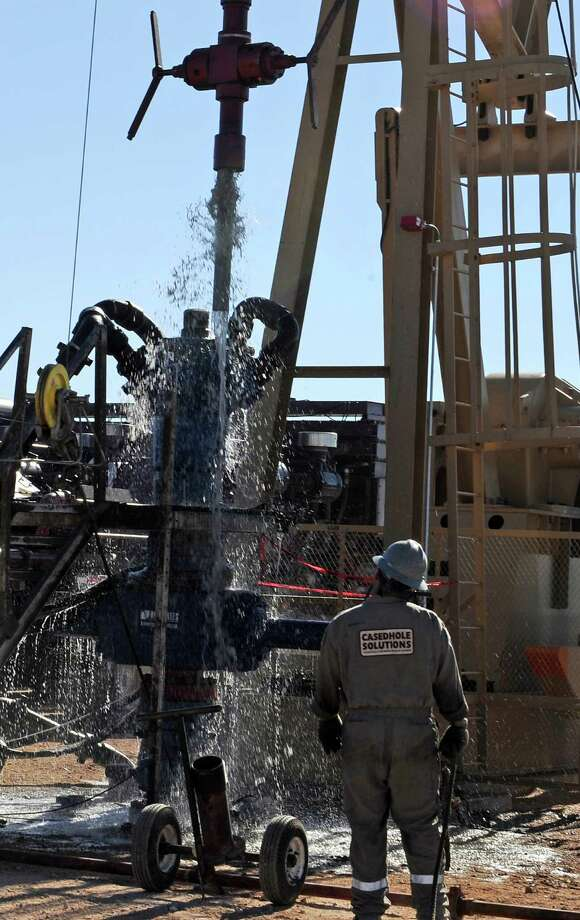 Hydraulic fracturing and other technology that fueled a U.S. shale oil production boom could lead to the production of billions of barrels overseas, according to an IHS report. Photo: Associated Press File Photo / AP2013