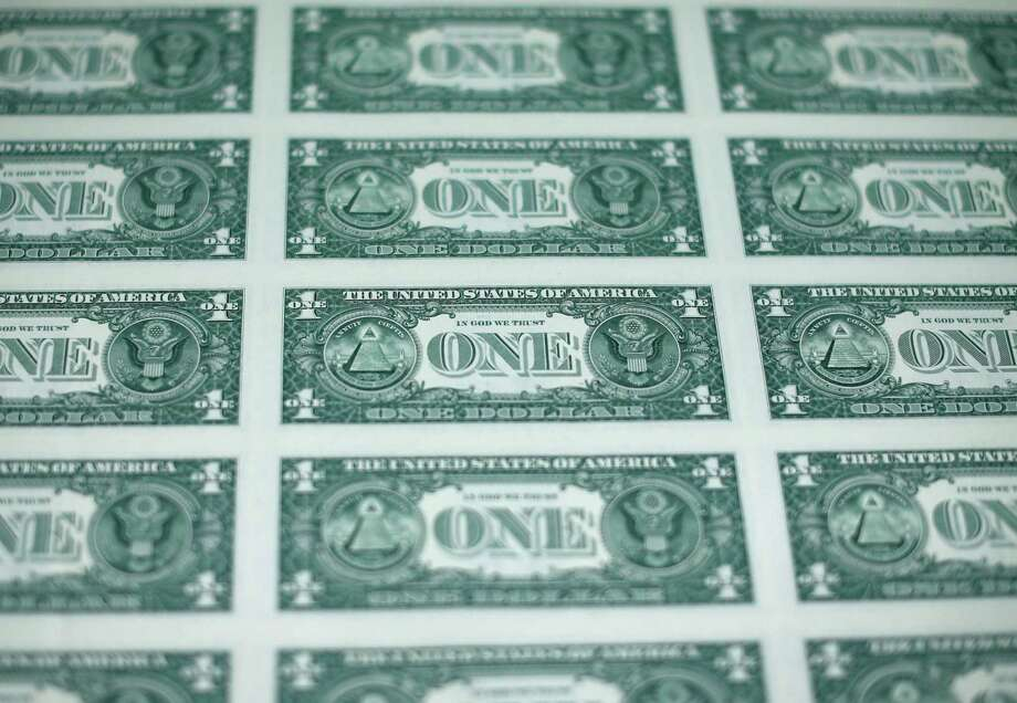 The value of the U.S. dollar, which often moves opposite the price of oil, peaked for the year in March, about the time this sheet of bills rolled off presses at  the Bureau of Engraving and Printing  in Washington. Oil hit its low for the year in mid-March.  (Photo by Mark Wilson/Getty Images) Photo: Mark Wilson, Staff / 2015 Getty Images