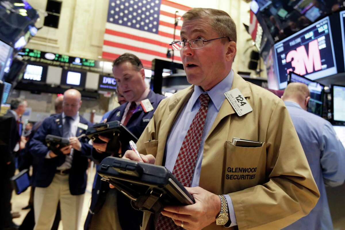 Trader David Williams, right, works on the floor of the New York Stock Exchange Friday, May 15, 2015. U.S. stocks are little changed in early trading a day after the Standard & Poor's 500 index closed at an all-time high. (AP Photo/Richard Drew) ORG XMIT: NYRD101