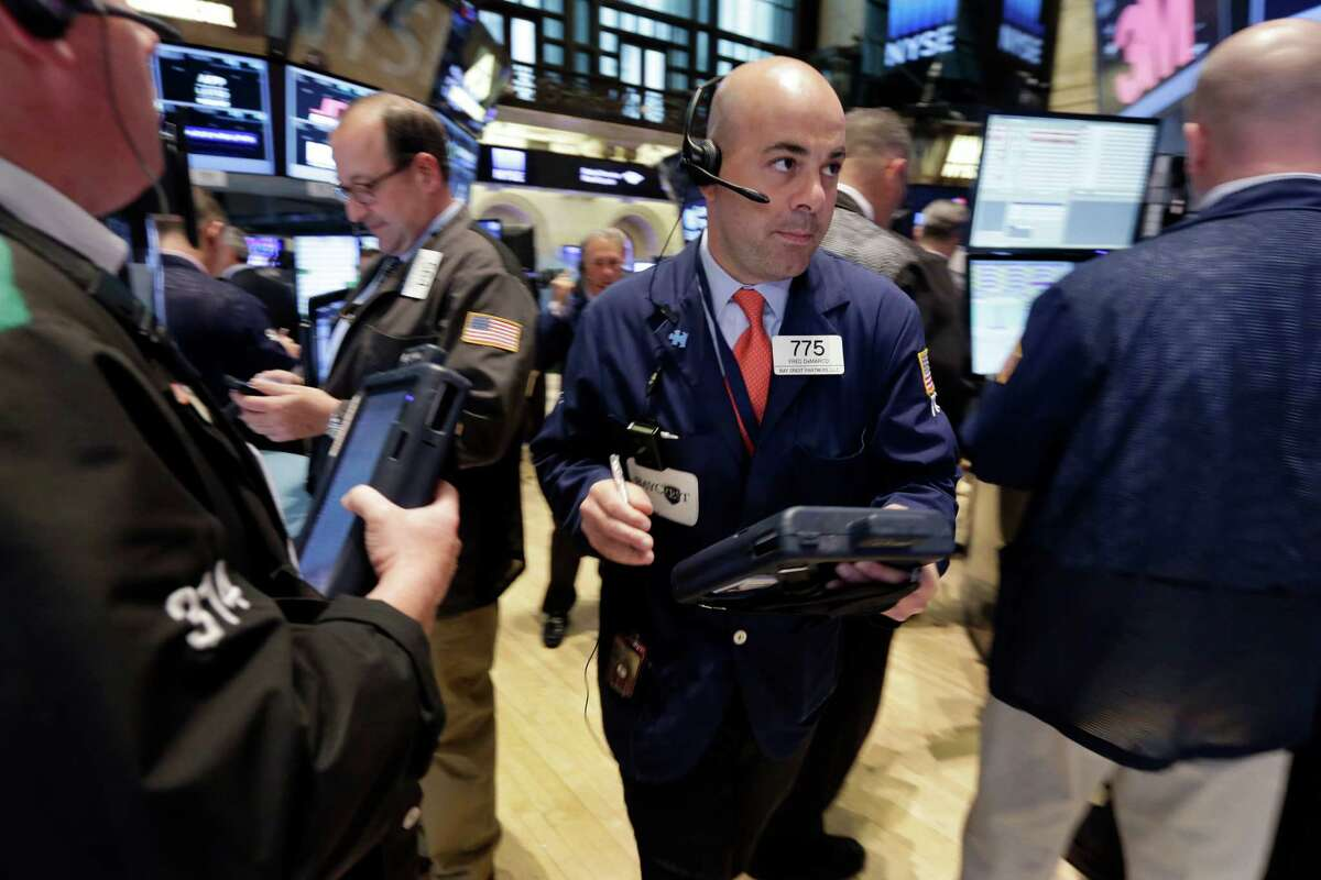 Trader Fred DeMarco, center, works on the floor of the New York Stock Exchange Friday, May 15, 2015. U.S. stocks are little changed in early trading a day after the Standard & Poor's 500 index closed at an all-time high. (AP Photo/Richard Drew) ORG XMIT: NYRD102