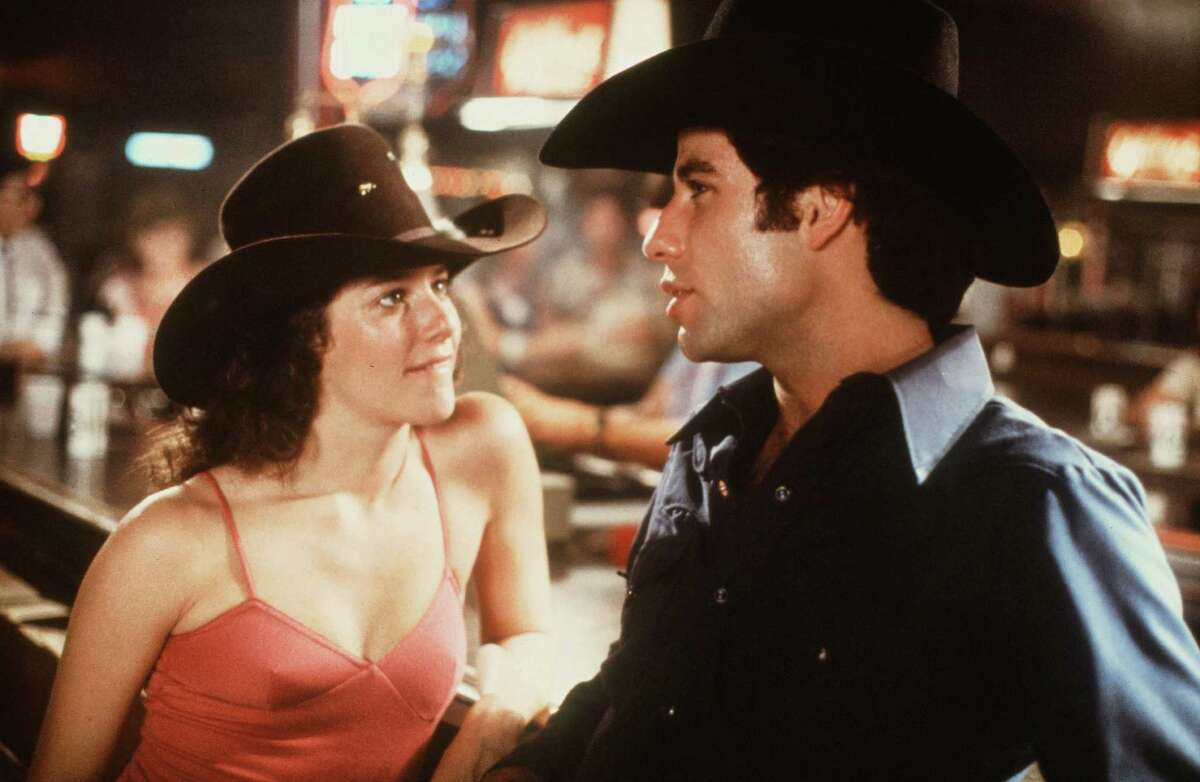 Debra Winger, seen here with Travolta, is pictured on the set of