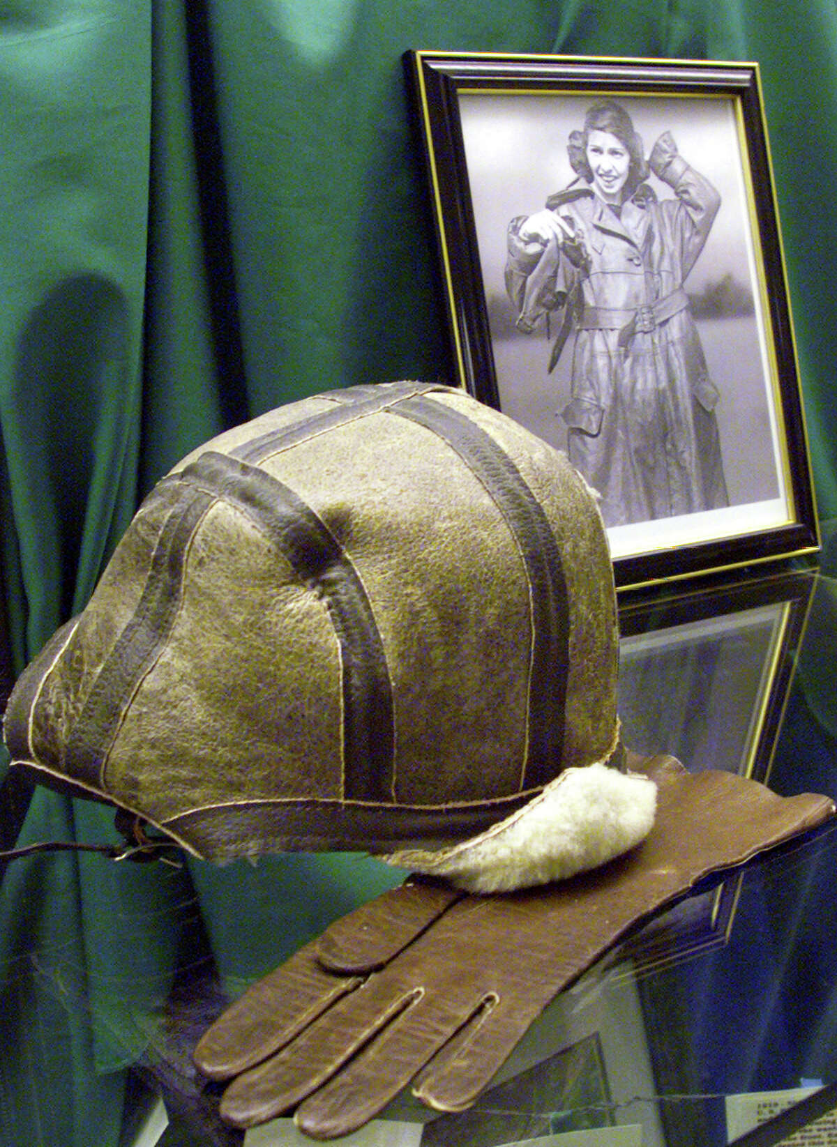 The flying hat and gloves once belonging to Katherine Stinson have been displayed in the hallway at Stinson Middle School on the northside.