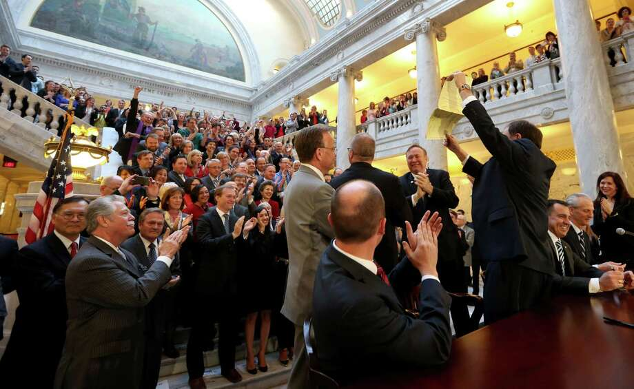 Utah Gov. Gary Herbert stands after signing an anti-discrimination bill at the Capitol in Salt Lake City. A Mormon church-backed anti-discrimination law that protects gay and transgender people and religious rights took effect Tuesday. Photo: Laura Seitz /Associated Press / The Deseret News