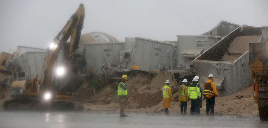 Crews work to clean up a train wreck in Pleasanton, Texas Friday May 15, 2015. The train was hauling gravel and there were no injuries reported. Photo: John Davenport, Staff / San Antonio Express-News / ©San Antonio Express-News/John Davenport
