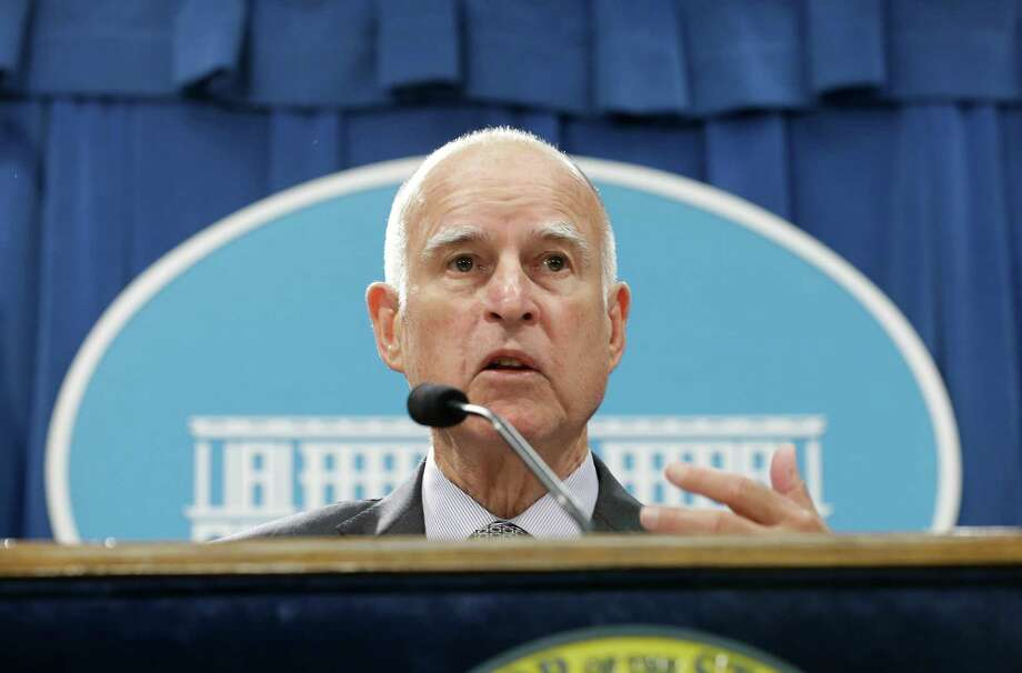 California Gov. Jerry Brown discusses his revised state budget plan during a news conference at the Capitol in Sacramento, Calif., Thursday May 14, 2015. Brown's $115.3 billion spending plan would send billions more to public schools and freeze in-state undergraduate tuition and establish a new state tax credit of the working poor. (AP Photo/Rich Pedroncelli) Photo: Rich Pedroncelli / Associated Press / AP