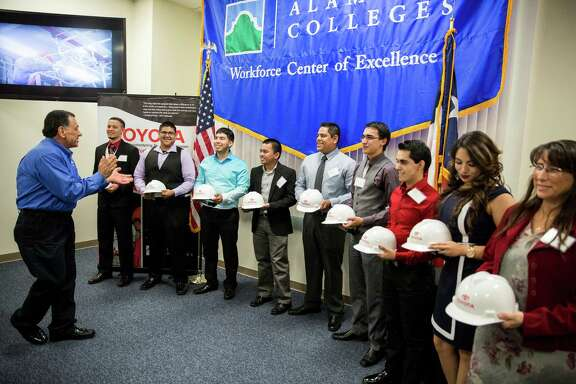 President Joe DaRose speaks to the graduates who are being hired by Toyota Texas during a ceremony to honor the first graduates of the Toyota Advanced Manufacturing Technician program at Alamo College's Workforce Center for Excellence on May 15, 2015, in San Antonio. The program allows students to work for the company while earning their degrees.