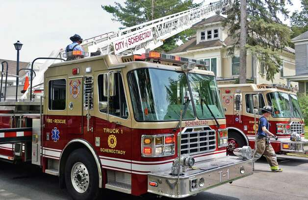 Firefighters battle a blaze at 1078 Parkwood Blvd. after an apparent attic fire Friday afternoon, May 15, 2015, in Schenectady, N.Y.  (John Carl D'Annibale / Times Union) Photo: John Carl D'Annibale