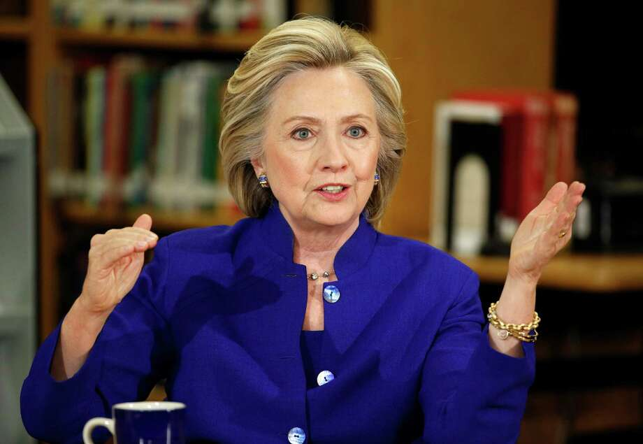 Speeches like this one by Hillary Rodham Clinton this month have earned her and former President Bill Clinton more than $25 million since January 2014. Photo: John Locher, STF / AP