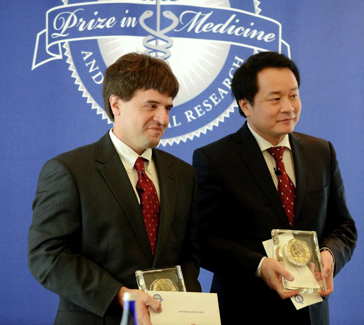 Dr. Karl Deisseroth, left, and Dr. Xiaoling Sunney Xie receive the $500,000 Albany Medical Center Prize in Biomedicine and Biomedical Research during an awards ceremony Friday, May 15, 2015, in Albany, N.Y. Karl Deisseroth, a professor at Stanford University, has been recognized for his work developing methods that allow scientists to understand how the brain?'s circuitry works, and how specific neurons play a role in conditions like Parkinson?'s disease, addiction and depression, as well as normal processes like memory and learning. Xiaoliang Sunney Xie of Harvard University was selected for work that allows scientists to pinpoint genomic changes in a single cell. His work has major implications in such fields as cancer research and in-vitro fertilization. (Will Waldron/Times Union)